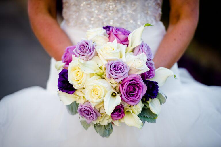 Purple rose and white calla lily bridal bouquet