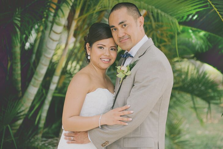 Ramil wore a neutral suit with a white and green orchid boutonniere that matched Maricel's orchid bouquet.
