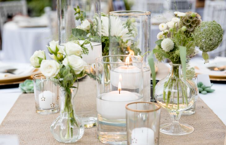 White candles and bundles of white roses served as centerpieces at Wildwood Acres Resort in Lafayette, California.