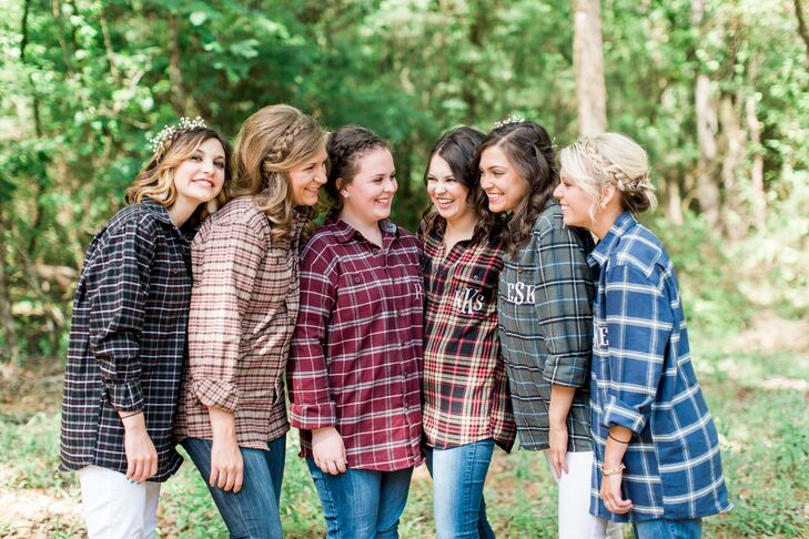 Keeping with the rustic theme, Karley and her maids opted for monogramed flannel shirts while getting ready for the big day.