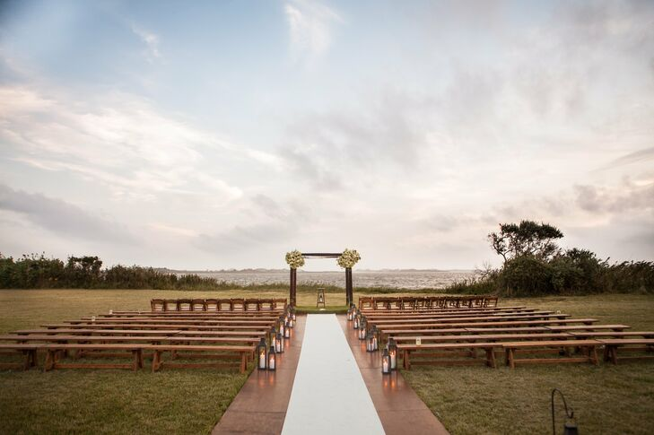 The outdoor ceremony took place on Ludlow Farm in front of Mecox Bay, amongst the sunflowers. Guests sat on wood benches in rows and the women were offered pashminas for the ceremony.