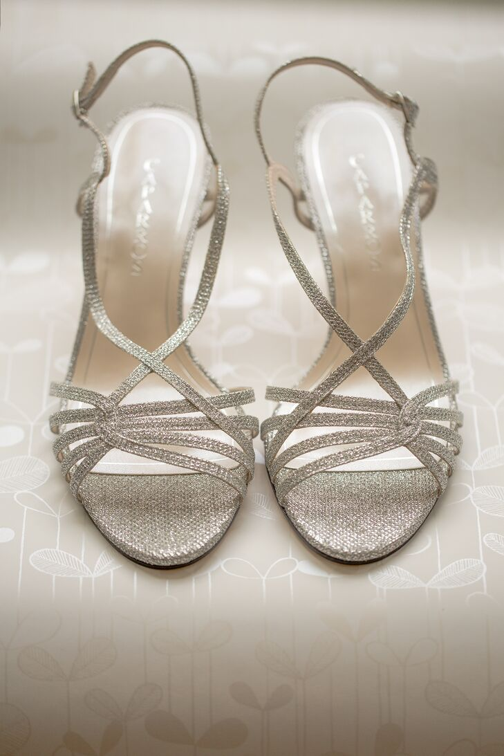 Heidi wore glitter silver strappy heels, adding a touch of glam to her bridal style.