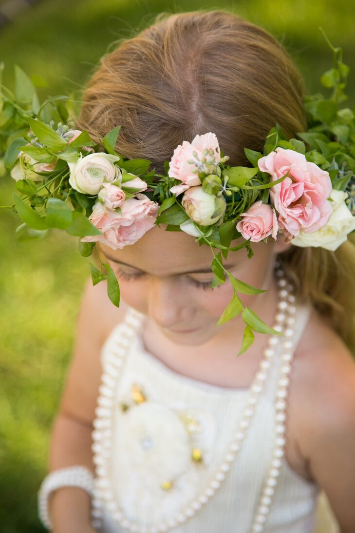 The flower girl wore a white dress with gold ballet flats and a flower crown to accent her curled hair. Lindsey gave her a strand of pearls to wear.