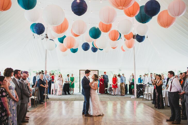 First Dance on Wood Dance Floor Beneath Colorful Paper Lanterns
