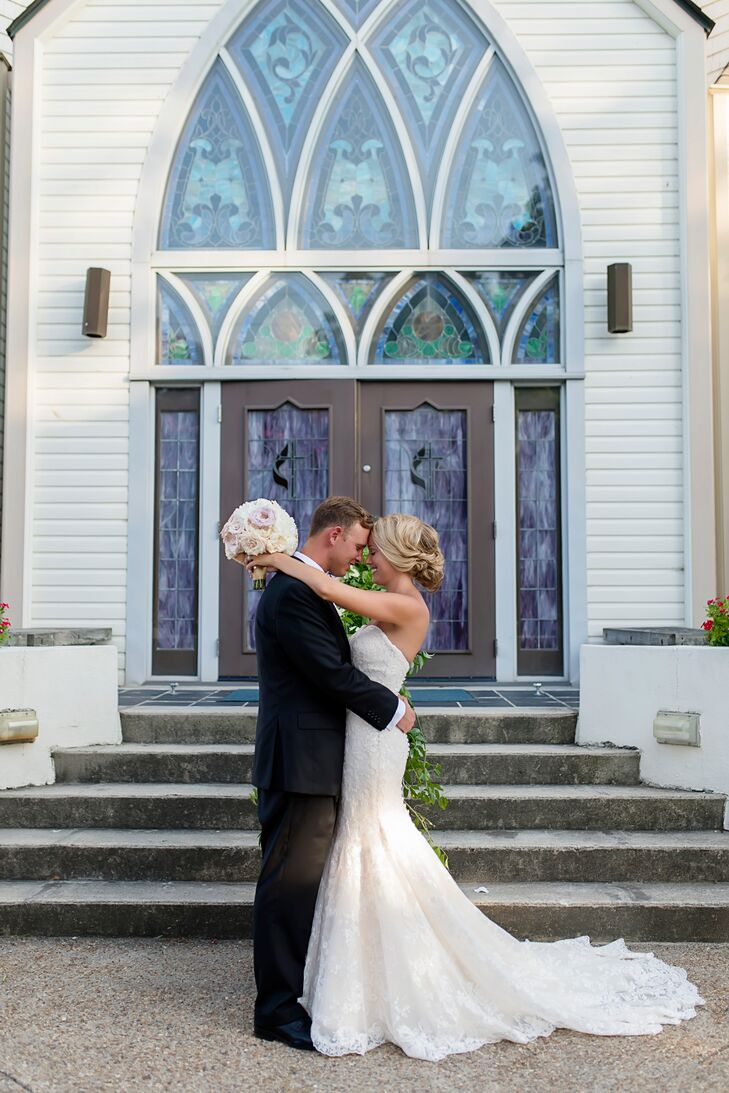 Caroline and Brian were married at Mount Olivet Methodist Church in the Outer Banks. Keeping the decorations to a minimum so as to not distract from its beauty, the couple added two large floral arrangements on the altar and greenery on the handrails of the stairs.