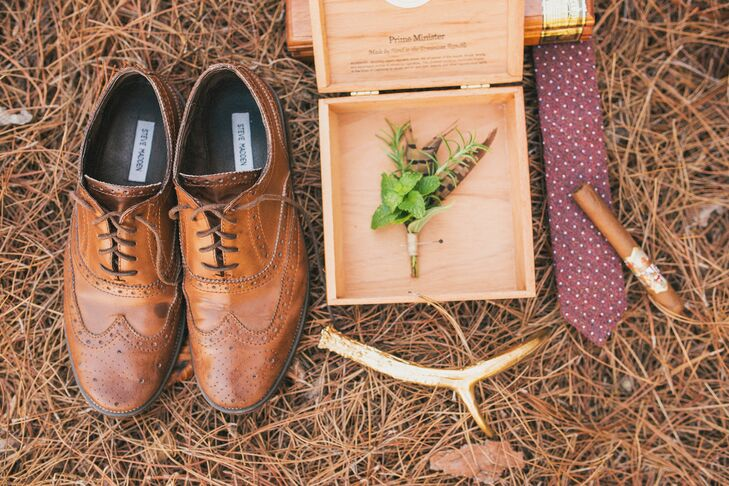 Amanda Jewel Floral + Design created boutonnieres that brought in many of the same fall elements of the bride and bridesmaid bouquets and the table settings. Greens and browns brought the fall look to life.