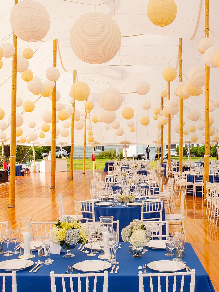 20 easy ways to decorate your wedding reception tented wedding reception with white and yellow paper lanterns solutioingenieria Choice Image