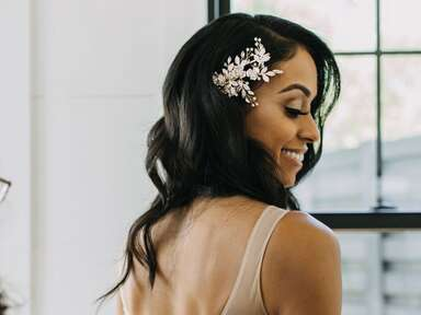Bride with long waves and hair clip and natural makeup