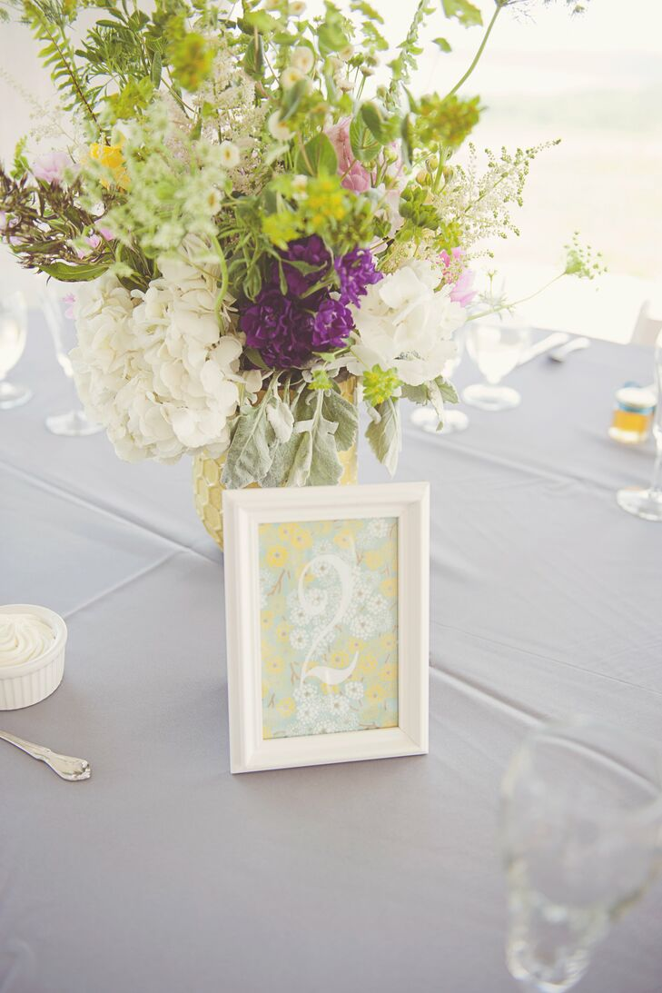 The bride made the table numbers using silk-screened fine paper and simple white frames.