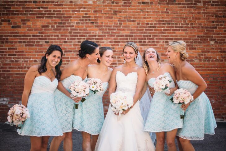 "The bridesmaids wore short blue Mori Lee strapless dresses with an ivory lace overlay. ""They were so cute and not typical bridesmaid dresses. It looked great on everyone,"" Morgan says."
