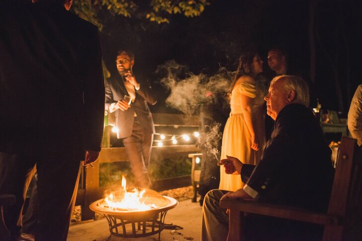 Guests were invited to roam the property at Rust Manor House in Leesburg, Virginia, with some guests sitting around a small fire pit enjoying cigars from the couple's cigar bar.