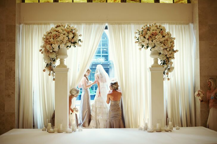 The bride entered the ceremony space through a parted airy curtain.