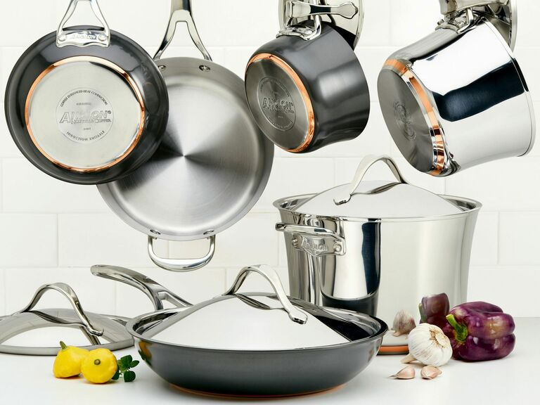 Anolon stainless steel and copper cookware set hanging in kitchen