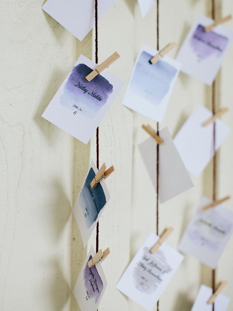 escort card hanging display purple watercolor