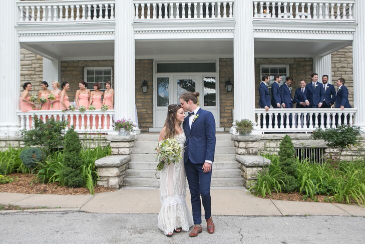 The bridesmaids wore strapless floor-length blush dresses and the groomsmen wore blue suits and ties for a fun, colorful look.