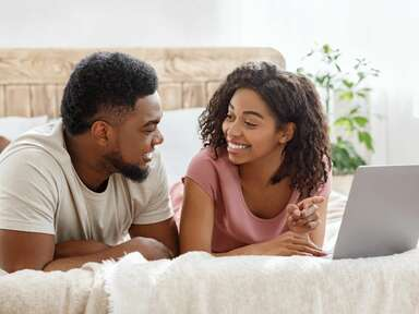Couple adding gifts to their wedding registry online