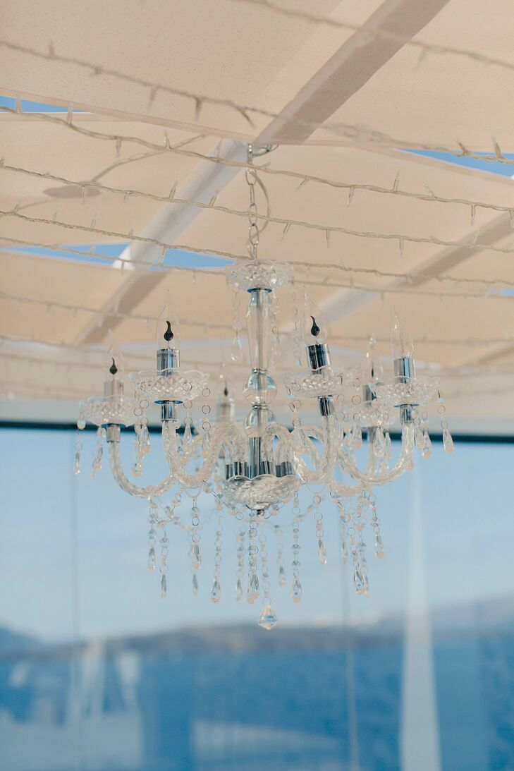 The crystal chandelier hung from the wire gazebo housing the wedding party at their outdoor reception.