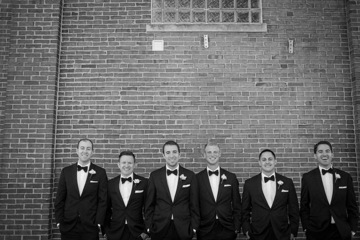 Each of the groomsmen wore classic black tuxedos and bow ties by Vera Wang.