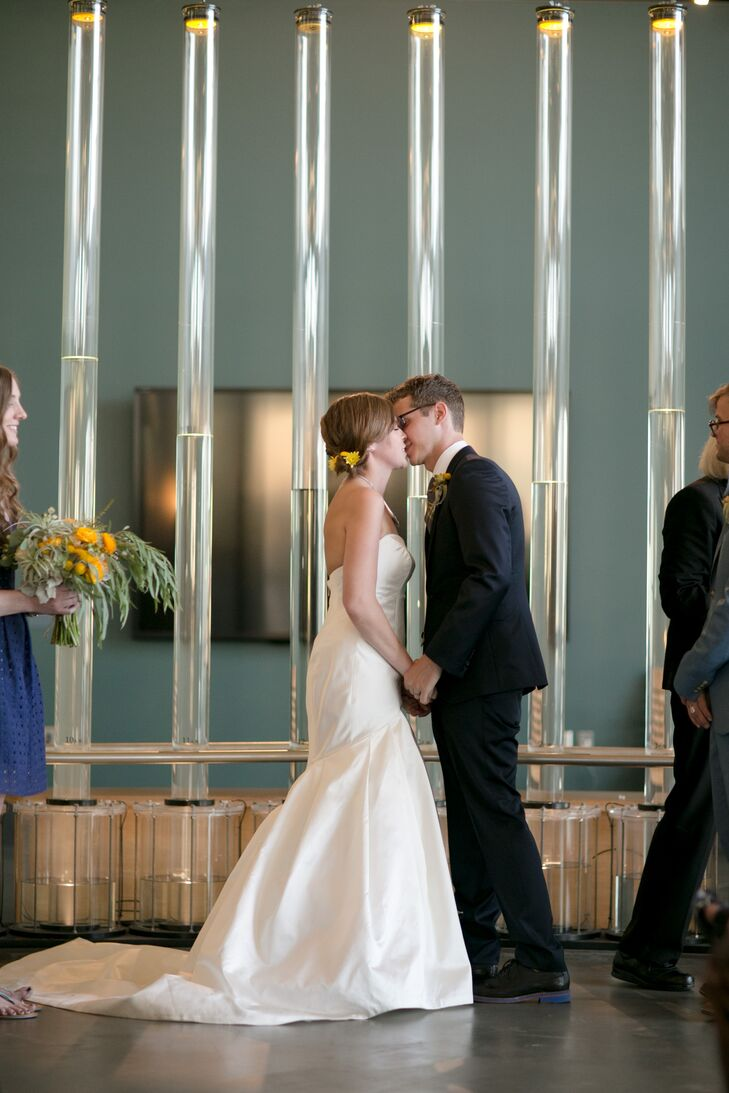 """Maddy and Matt held their ceremony in front of a water and light reflection exhibit at the Exploratorium. """"The East Gallery has sweeping views of the San Francisco Bay, Treasure Island and the San Francisco Bay Bridge,"""" Maddy says. """"The space did not require any decor."""""""
