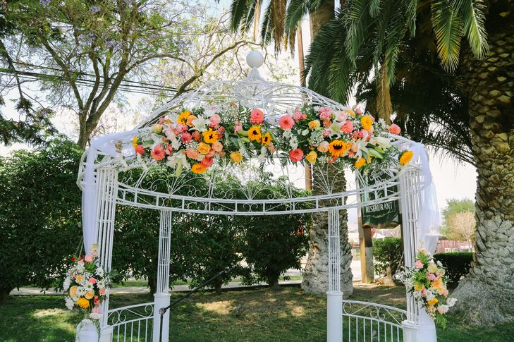 White Ceremony Arch with Flowers