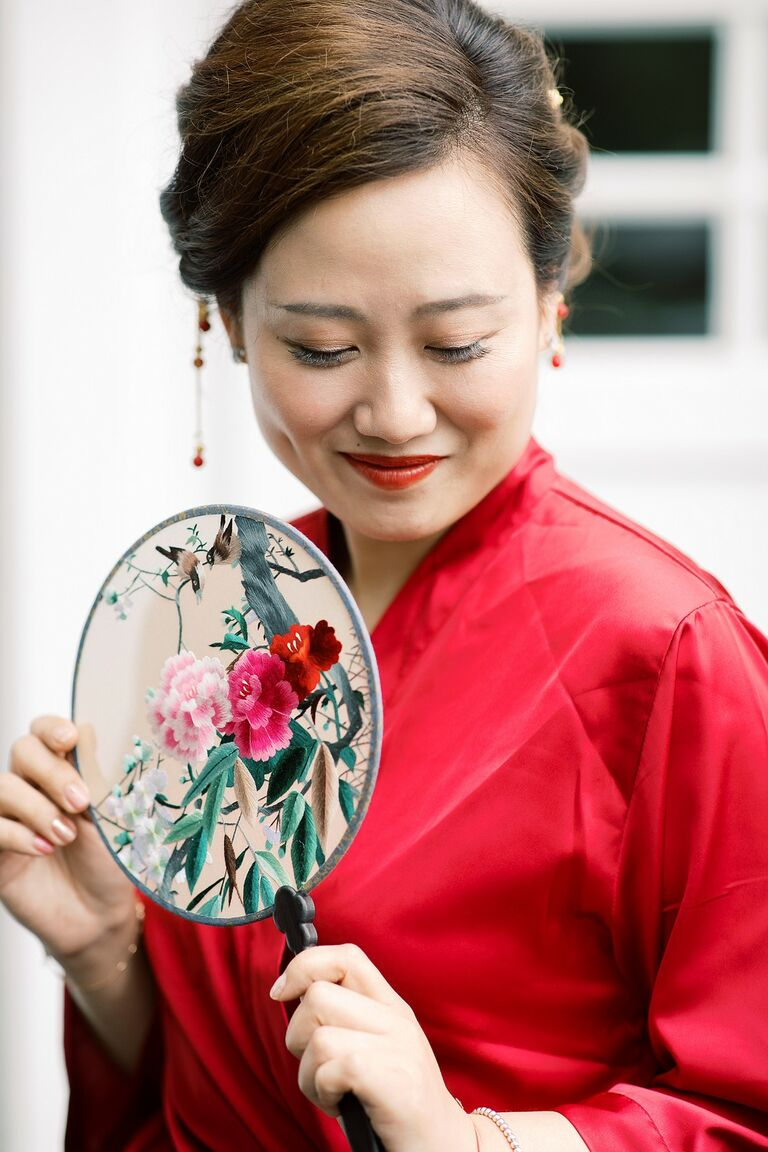 Chinese bride holding ornate fan