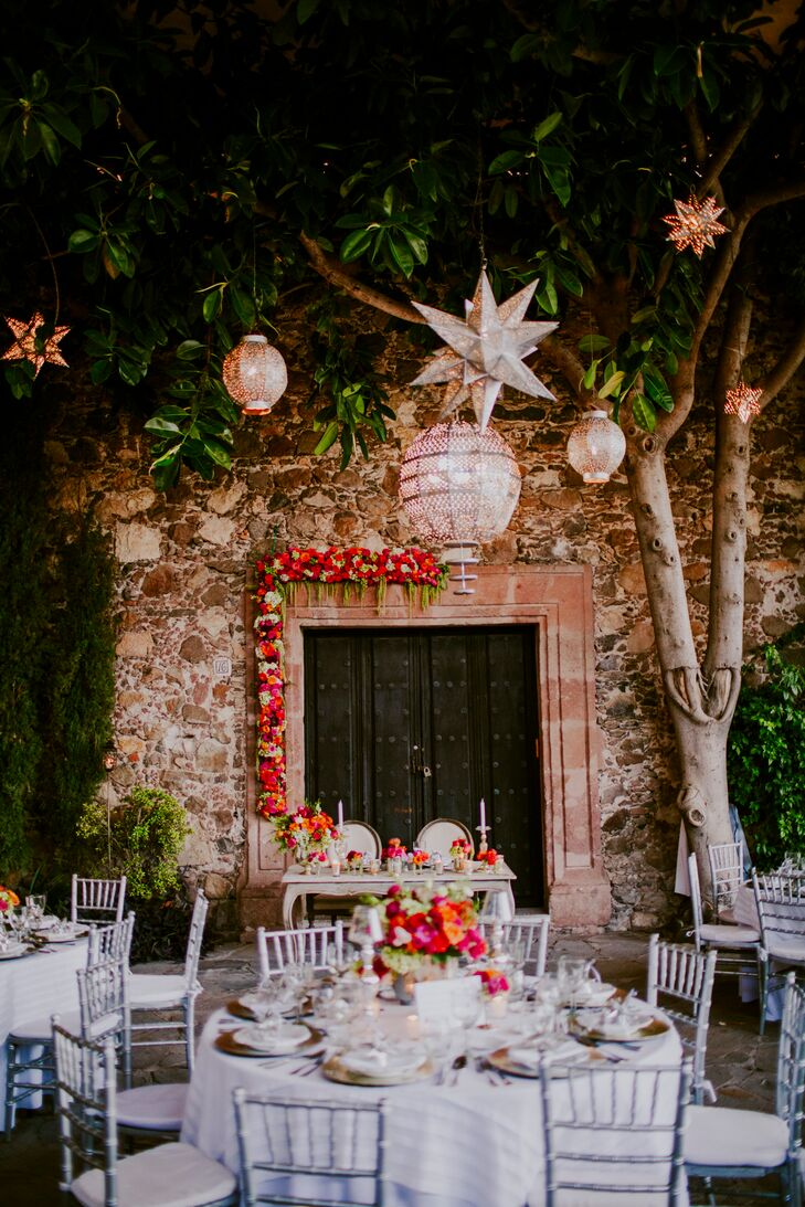 Above the elegant dressed reception tables hung dozens of silvery lanterns in a variety of shapes and styles. As the sun set over Instituto Allende, the lanterns began twinkled and glowed, casting warm, whimsical light over the outdoor reception space.
