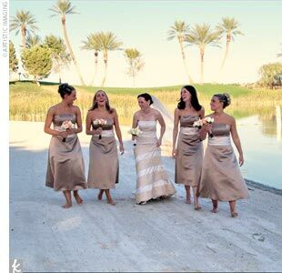 Playing up their location, Piper and Jim chose a palette of desert hues -- sage green, chocolate brown, and pale peach. Piper's four bridesmaids wore strapless, satin tea-length dresses in taupe with champagne-colored sashes by Bill Levkoff.