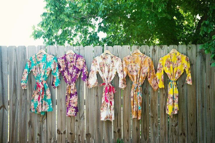 Nicole and her bridesmaids all wore different shades of brightly patterned silk robes while getting their hair and makeup done.