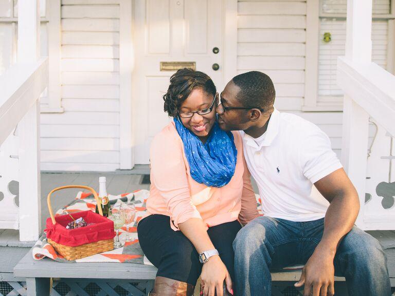 Engaged couple having a romantic picnic