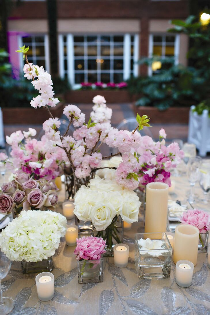 The round table centerpieces were made up of small vases filled with arrangements of hydrangeas, peonies and roses.