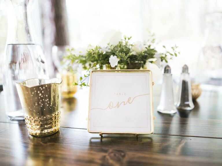 spring wedding centerpieces simple greens with metallic accents