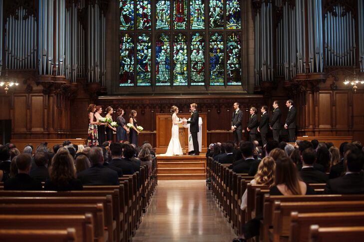 """Linsey and Cliff wanted a way to have their guests actively participate in the ceremony. Instead of a traditional unity candle lighting, the couple provided their family members and friends with LED candles and dimmed the lights at the end of the ceremony, allowing the warm candlelight to illuminate the church. """"It reflected how the love and support of our friends and families would serve as a guiding light for Cliff and I as we start our life together,"""" says Linsey."""