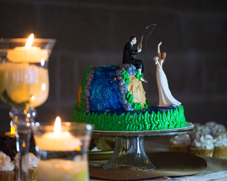 """""""Our cake embodied our love of fishing,"""" Larrissa says. """"It was the most personalized touch we added. We are avid crappie fishers, and our two-tier cake was of a man fishing and catching his bride."""""""