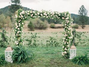 Floral Ceremony Arch With Greenery and Cream Roses