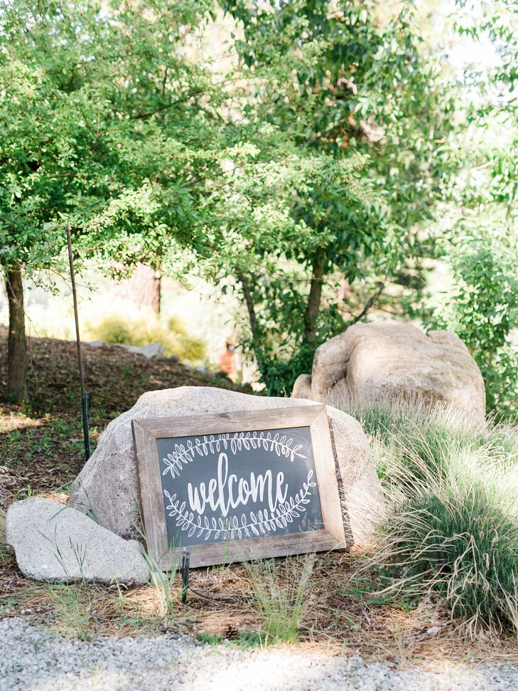 A simply framed chalkboard sign welcomed guests to the outdoor event in Verdi, Nevada.
