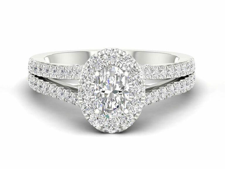 Jenny Packham oval diamond engagement ring with diamond halo and split shank diamond setting