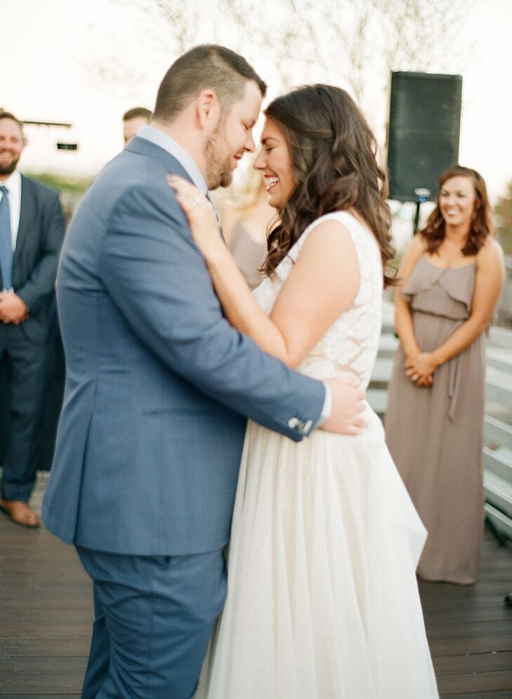 "Marissa and Scott's first dance was to Aaron Neville's ""Crazy Love,"" with includes the lyrics ""I can hear her heartbeat from a thousand miles, and the heavens open up every time she smiles."" The singer was a favorite of Scott's mom."