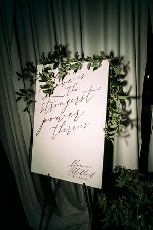 Whimsical Black-and-White Sign with Greenery and Calligraphy