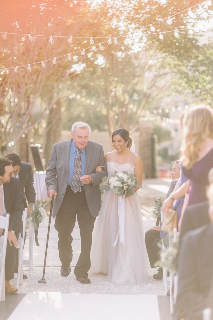 """Before the ceremony a lineup of tunes included Electric Light Orchestra's """"Strange Magic,"""" Aerosmith's """"I Don't Wanna Miss a Thing"""" and Journey's """"Faithfully."""" Jennifer and her father walked down the aisle to """"All You Need Is Love"""" by the Beatles."""
