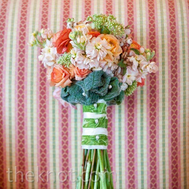 The bridesmaids' carried multicolored bouquets, filled with soft-hued blooms.