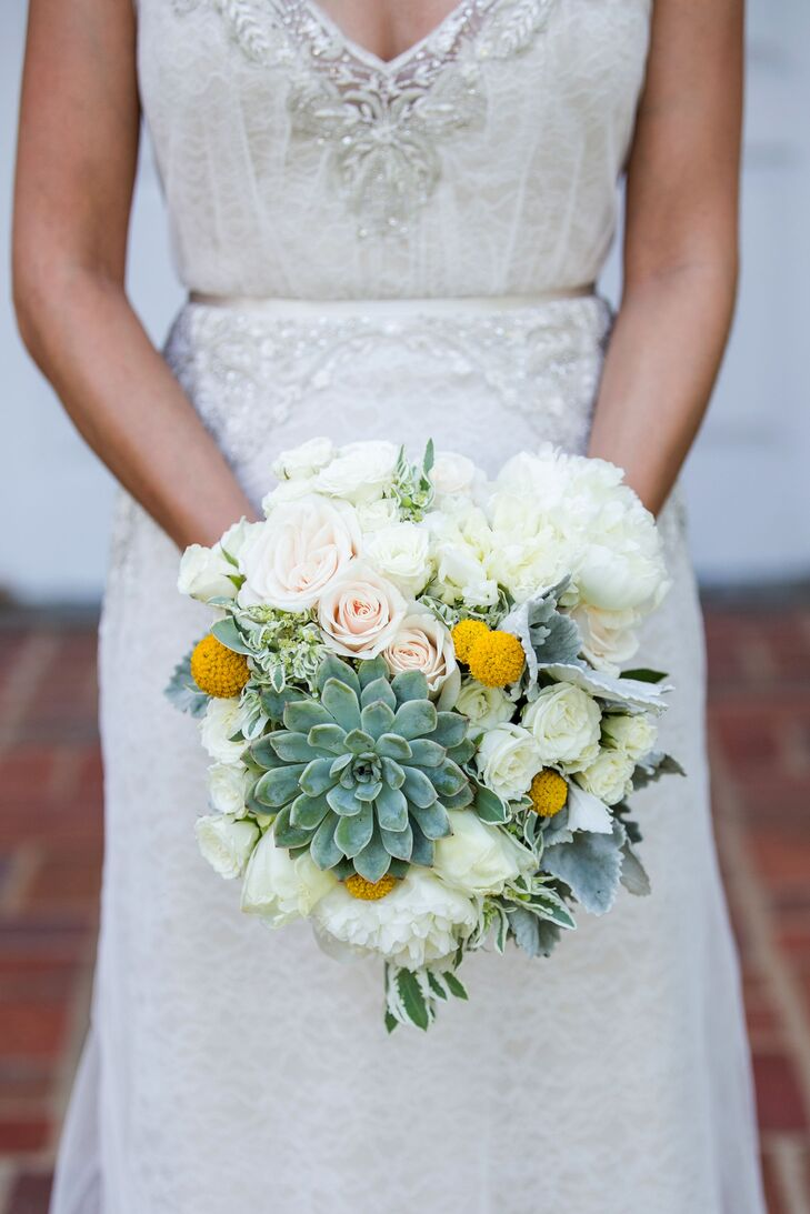 """Lindsey held onto her bouquet filled with white roses, green succulents and yellow craspedia. """"I chose the flowers for all the bouquets based on our color scheme,"""" Lindsey says. """"Trying to find mint flowers is difficult, so I made that the starting point for choosing florals."""""""