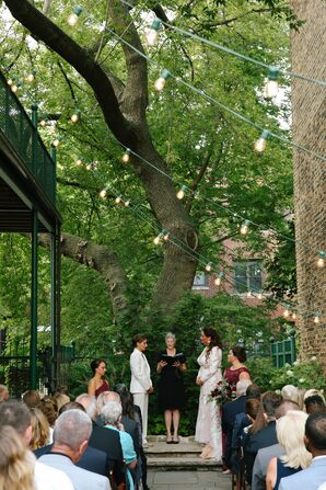 Simple Outdoor Ceremony Decorated with Sting Lights Overhead