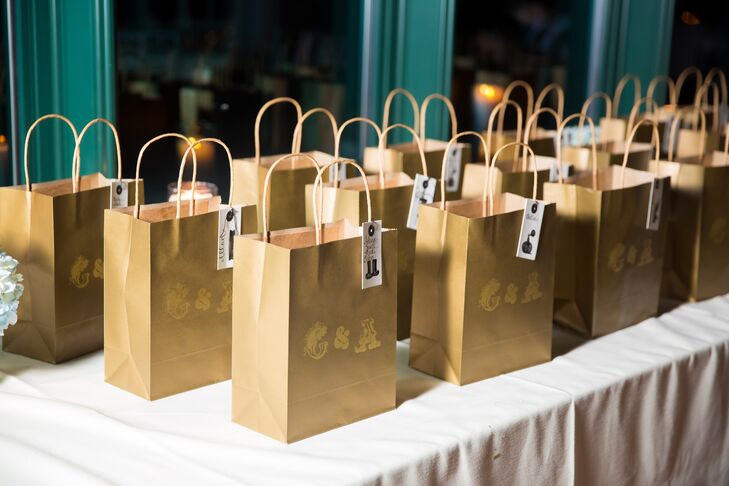 Galina and Andrew sent their guests home with custom pint glasses wrapped in gold embossed gift bags featuring their monogram and the name of each guest hand-calligraphed on the front.