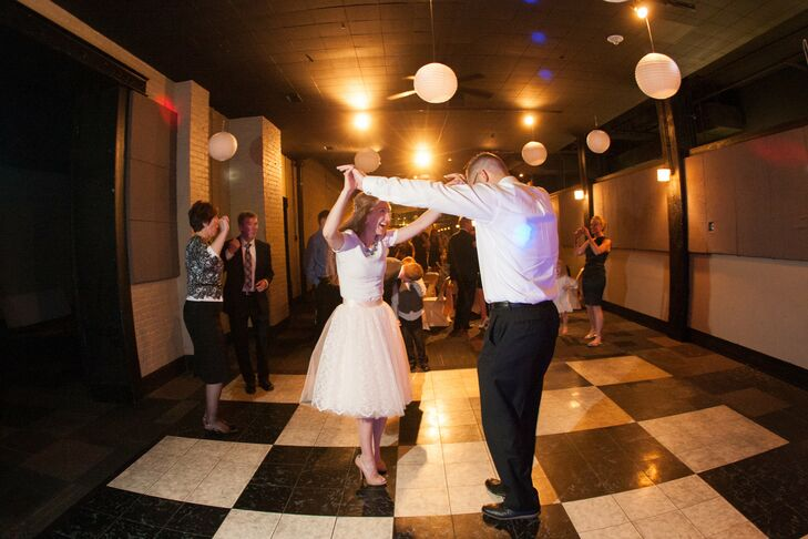 """As much as Laura loved her wedding dress, she knew she couldn't dance in it and didn't want a bustle, so she changed into another look for the reception. """"I changed into a 'tutu' of sorts from Space 46 Boutique in California and a J.Crew shirt that zipped up the back."""""""