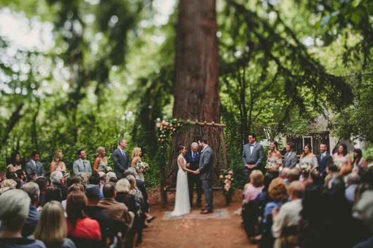 Crystal and Keith were married at the foot of a huge redwood tree under an arbor Keith and his family crafted from fallen branches and fresh flowers.
