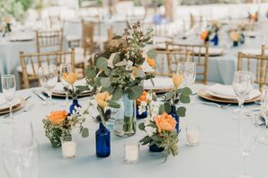 Vintage Bottle Centerpiece with Eucalyptus and Peonies