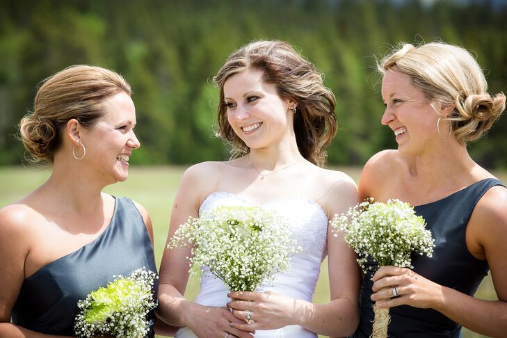 The bride and bridesmaids carried the same bouquet: a light green aster surrounded by Baby's Breath.