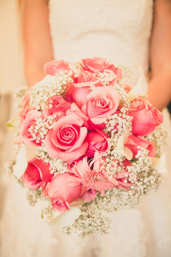Sarah carried a lush bouquet of classic pink roses dotted with wispy baby's breath down the aisle.