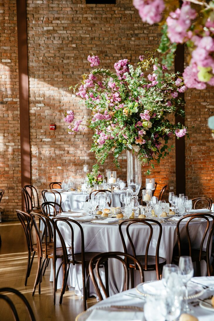 For a spring wedding, a few cherry blossoms were a must. Fleurs NYC delivered in a big way, creating standout arrangements. The mix of towering centerpieces with low, garden-inspired arrangements brought a touch of visual intrigue and drama to the room.