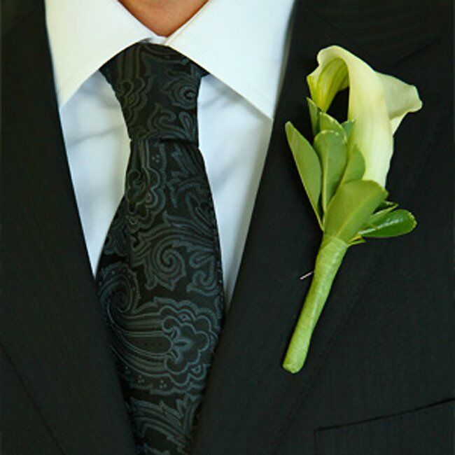The groom wore a small white calla lily to contrast with his designer, black-on-black striped suit from Hugo Boss.